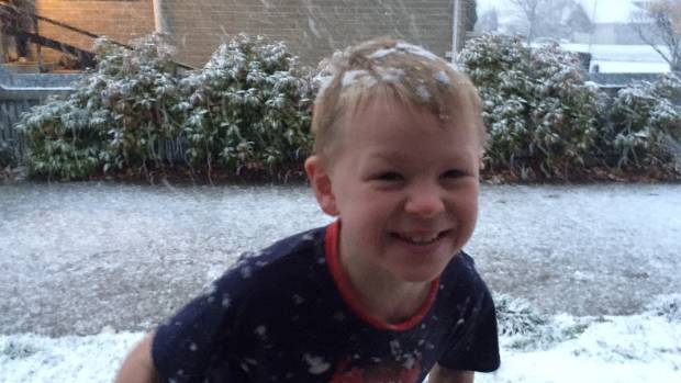 Cromwell's Travis Chamberlain, 6, is tough enough to handle the snow in his PJs.