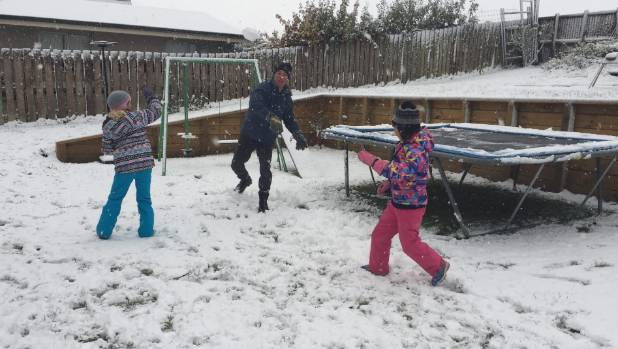 The Argyle family kick off the weekend with a snowball fight in Queenstown.