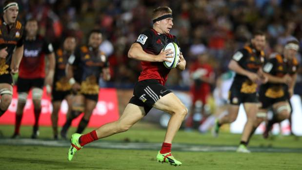 Crusaders centre Jack Goodhue makes a break against the Chiefs in Suva on Friday.