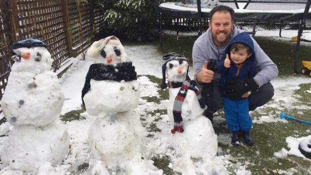Lee and Eddie Saunders (Eddie 2.5 years, Lee's age  undisclosed) celebrate Eddie's very handsome first snowman.