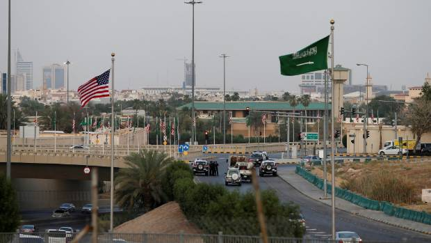 Saudi Arabian and US flags are seen on Meccah Road as security check points are set up ahead of Trump's arrival in Saudi ...