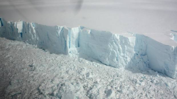 A 20 metre-high ice cliff forming the edge of the Wilkins Ice shelf on the Antarctic Peninsula is seen from a plane ...
