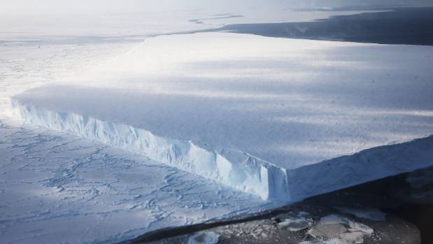 An iceberg floats near the coast of West Antarctica as seen from a window of a NASA Operation IceBridge airplane on ...