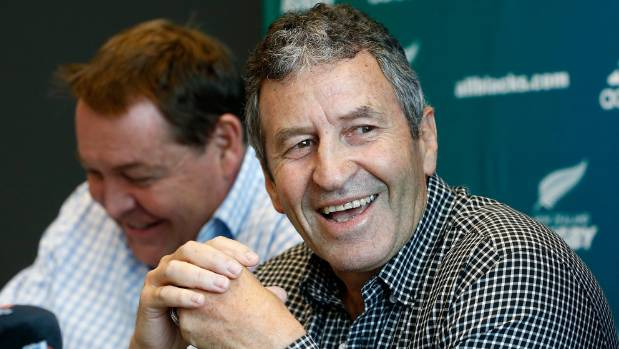 Wayne Smith announces his retirement beside Steve Hansen in Auckland on Friday.