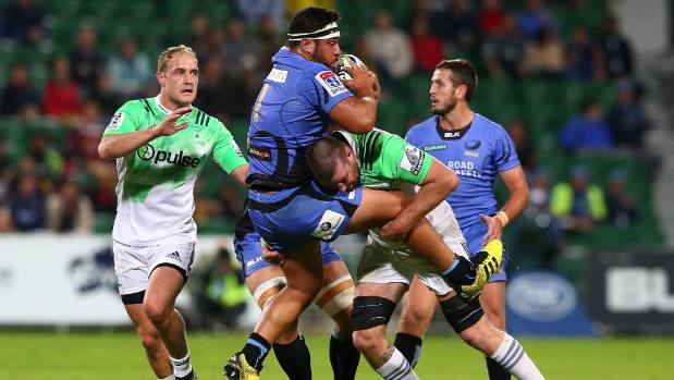 Highlanders lock Alex Ainley tackles Pek Cowan.