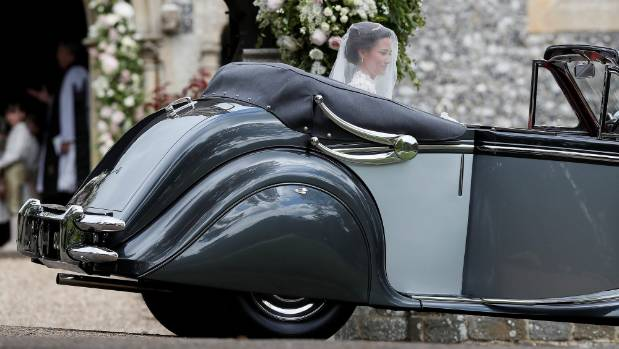 Pippa Middleton sits in a car at the wedding venue, which a number of the British royal family to attend.