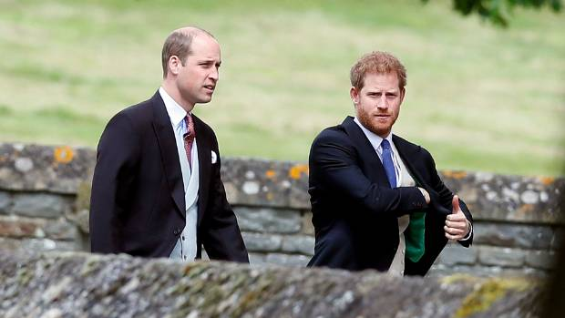 Prince William and Prince Harry arrive for the wedding.