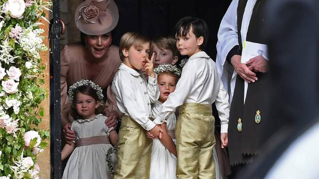 Catherine, Duchess of Cambridge, stands with her daughter Princess Charlotte and other children as they arrive for the ...