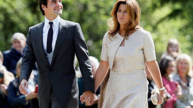 Swiss tennis player Roger Federer and his wife Mirka arrive at the wedding.