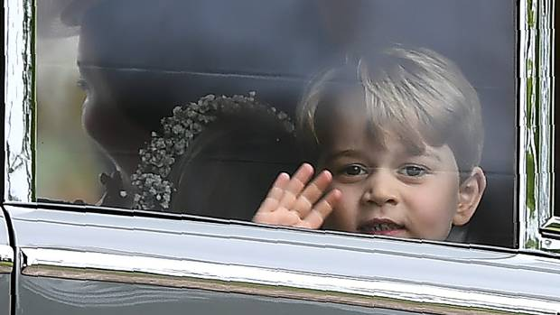 Prince George waves as he leaves in a car after attending his aunt Pippa Middleton's wedding,