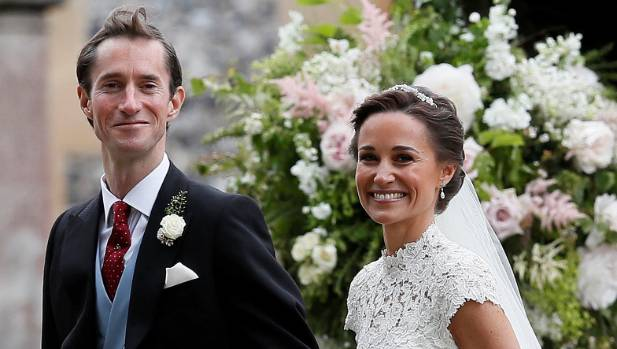 Pippa Middleton and James Matthews are all smiles after their wedding.