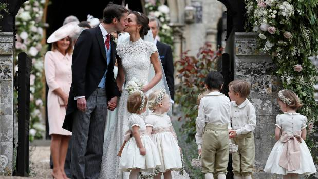 Pippa Middleton and James Matthews kiss after the wedding.
