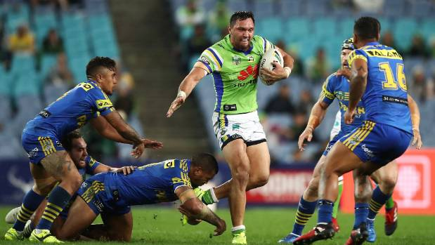 Jordan Rapana skips out of a tackle as the Eels' defence closes in.
