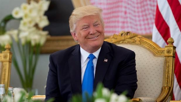 U.S. President Donald Trump has coffee during a reception ceremony in Riyadh, Saudi Arabia.