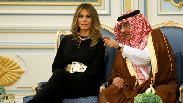 US first lady Melania Trump dressed conservatively, but shunned a headscarf, on her first day in Saudi Arabia.