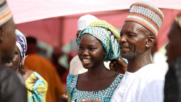One of the newly released 82 Chibok school girls reunites with her family in Abuja, Nigeria.