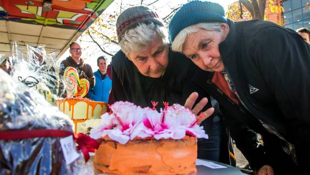 Top cakes for Topp Twins - Lynda, left, and Jools scrutinise the best cakes on sale at the Little Cuba Carnival in George St.