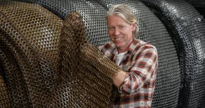 Kayne Horsham of Kaynemaile designs mesh that looks like chain mail, but is made of plastic.