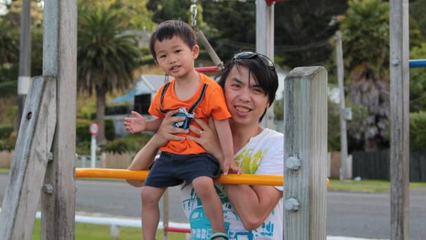 Alpha Leung and his son Ashton, aged four, who is already a share investor.