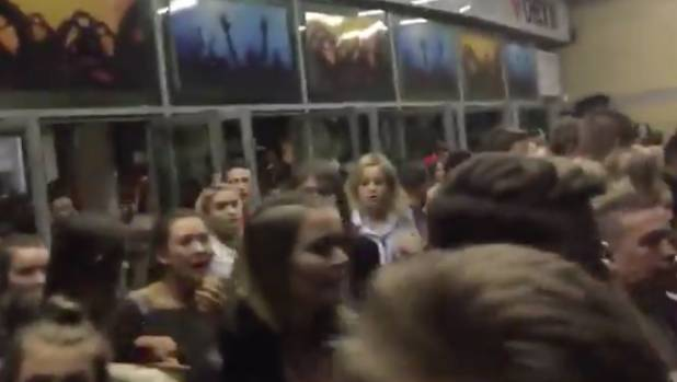 Panicked concertgoers in the foyer of the arena.