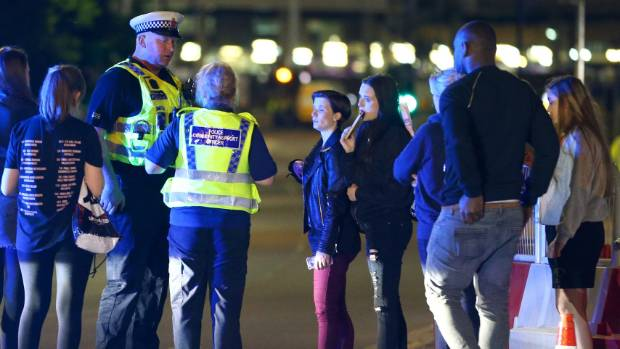Police talk to fans caught up in the blast near the Manchester Arena.
