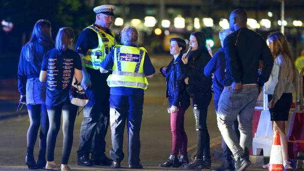 Police and fans close to the Manchester Arena after the explosion.