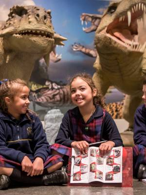 Daytona Barker, 7, Eloise Careswell-King, 7, and Kamryn Sewell, 8, learn about life before dinosaurs.