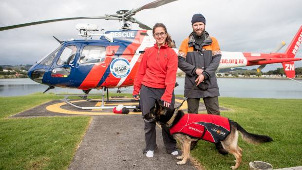 Batel Rosenkrantz from Israel with rescuer Graeme Hill with Gemma, 8, police search dog bunked down for the night on Mt ...