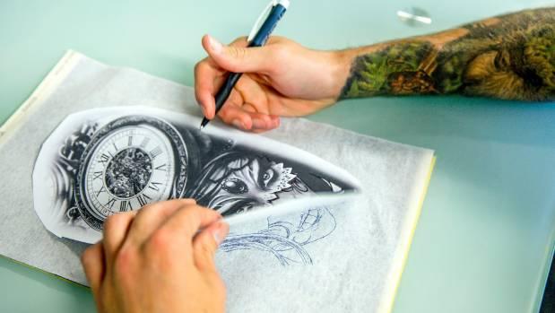 Mikal Carter (aka Mantis Mike) works on a design.