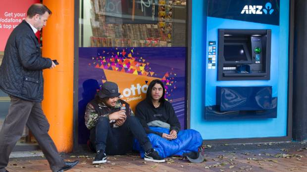 Beggars near an ATM machine in Manners St, Wellington, on Tuesday. Businesses in the city consider it to be one of the ...