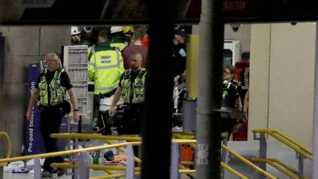 A man can be seen being stretchered out of Manchester Arena.