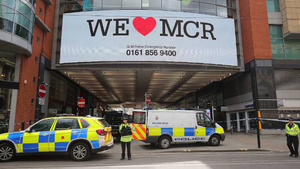 Police avacuate the Arndale Centre in Manchester, England, a day after a suicide bombing killed 22 people at Manchester ...