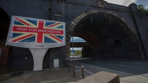 "A giant TV advertisement screen, next to a railway bridge, displays ""Pray For Manchester"" after Monday night's terrorist ..."