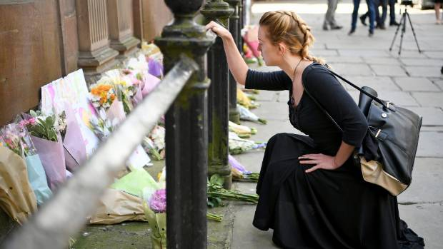 Members of the public lay flowers in St Ann Square in Manchester, England, a day after 22 people were killed in a ...