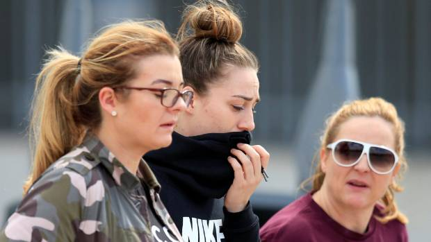 Distraught people walk out of a support centre at Manchester City's Etihad Stadium in the wake of the suicide bombing.