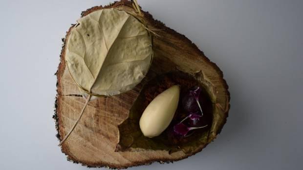 Burnt sugar hāngi pudding, kaanga wai (fermented corn) ice cream and preserved Otago cherries.