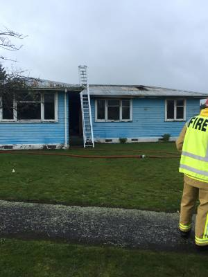 An early morning fire destroyed this house on Cameron Crescent in Masterton on Wednesday morning.