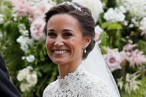 The future Lady and Laird of Glen Affric, Pippa Middleton and James Matthews, smile after their wedding at St Mark's ...