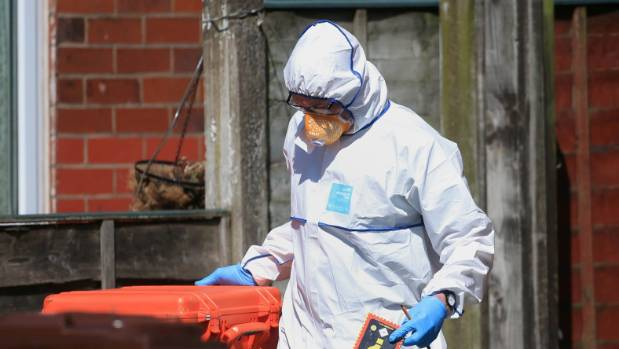 A police forensic investigator at an address in Elsmore Road, Greater Manchester, after the bombing.