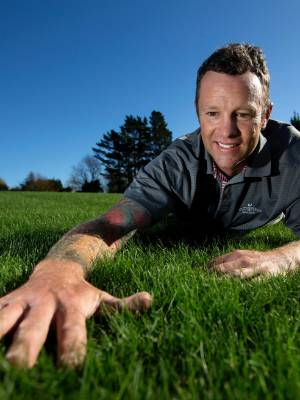 Owner of Taranaki Turf Doctor Brad Voullaire checks the quality of his product.