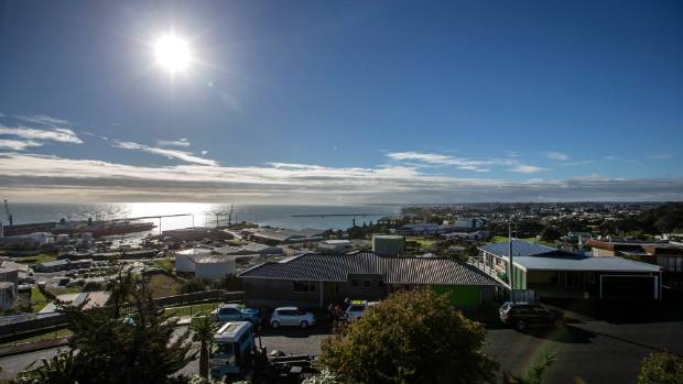 The property is on a street with sweeping views of Port Taranaki and New Plymouth.