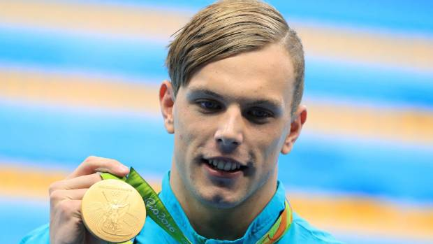 Olympic 100-meter swim champion to have heart surgery