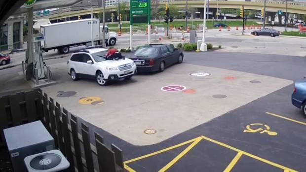 Woman stops carjacker by jumping onto hood
