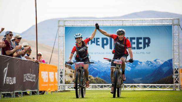 Queenstown riders Kate Fluker and Mark Williams cross the finish line in 2017.