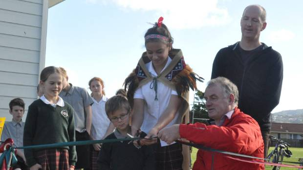 Kaymon Wilcock, 12,  helps cut the ribbon as, from left, Catherine van der Gulik, 8,  Leighton Woledge, 5,  Trevor ...