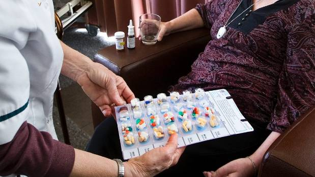 A district nurse checks the medication of a palliative care patient. (File photo)