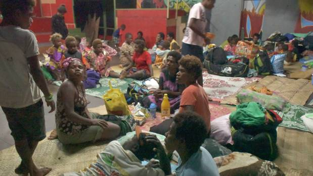 Families sheltering inside the Wan Smol Bag Yut Senta in Port Vila ahead of Cyclone Donna.