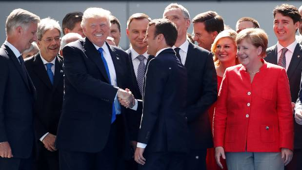 Fellow G-7 leaders have been pressuring Donald Trump to keep the US a party to the Paris climate accord.