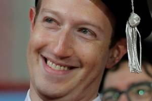 Facebook founder Mark Zuckerberg acknowledges a cheer from the crowd before receiving an honorary Doctor of Laws degree.