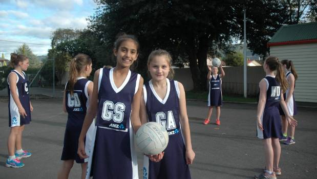 Co-captains Jasmin Kaur and Kera Birdsall and the Trentham School Rockets team in their new and much needed playing uniforms.